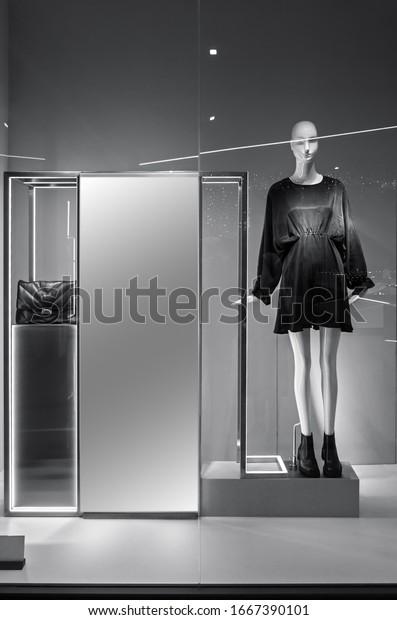 mannequin-standing-store-window-display-