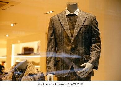 Mannequin in stylish gray suit, on showcase, in the men's clothing store. Shopping concept.