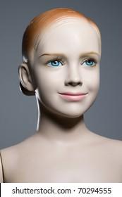 Mannequin tailors, plastic figure of girl on dark background