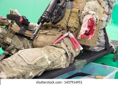 Mannequin of a wounded fighter with a severe wound on a stretcher. Medicine