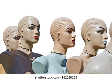Mannequins - beautiful female heads close-up, isolated over white
