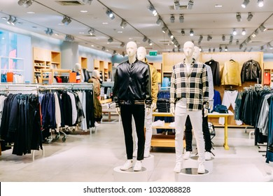 Mannequins Dressed In Male Man Casual Clothes And Clothes On Shelves And Hanger In Store Of Shopping Center.