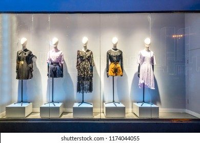 2cf6e172703 mannequins with modern clothes in fashion store display window