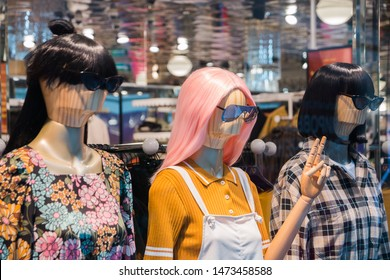 mannequins with modern clothes in fashion store display window. Russia, Moscow, July 2019