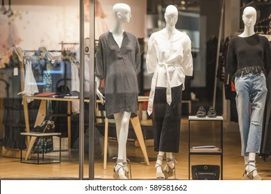 Mannequins in a storefront of an elegant store.