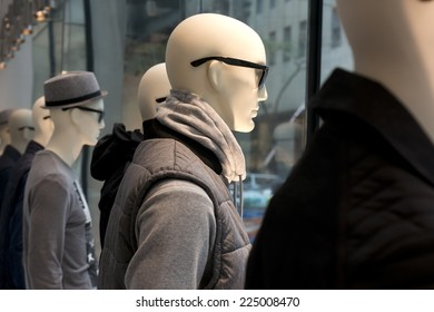mannequins in a storefront window