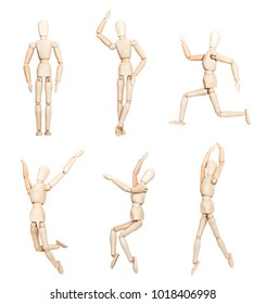 Mannequins in various positions. Wooden mannequins standing, sitting, running, dancing, jumping.
