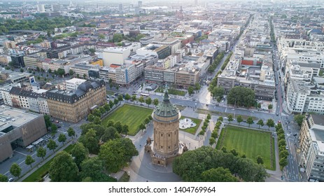 Mannheim, Baden Württemberg / Germany - 05 19 2019: Aerial Cityscape of Mannheim, Germany with Water Tower Park and Street