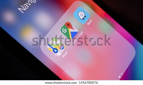 Mannheim - Baden Württemberg / Germany  07.21.2019: Close Up of Smartphone Display with Navigation Application Icons Apple Maps, Google Maps, Waze