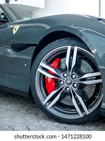 Mannheim, Germany - 07 28 2019: Close up of the rims of a Ferrari Portofino parked in front of a hotel in Mannheim.