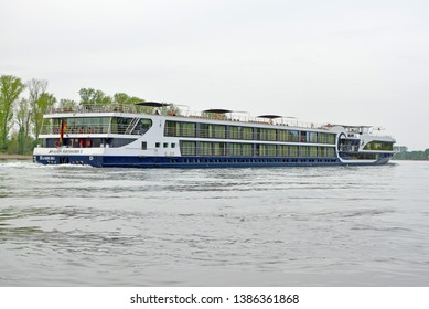 Mannheim, Germany - April 2019: German cruise ship called Avalon Artistry II with passengers on the Rhein river