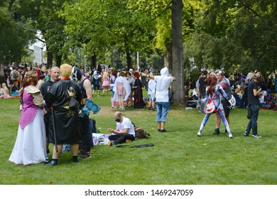 Mannheim, Germany - August 2019: Cosplayers gathering at public park called 'Friedrichsplatz' in Mannheim during anual anime convention
