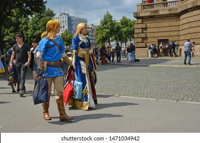Mannheim, Germany - August 2019: Cosplayers walking by at public park in front of water tower in Mannheim during anual anime and manga convention