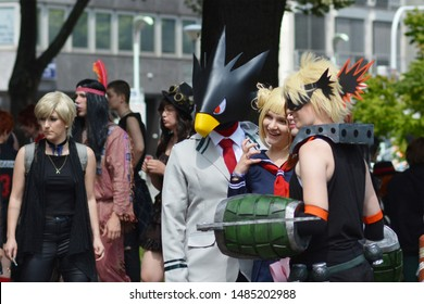 Mannheim, Germany - August 2019: Cosplayers from series 'My Hero Academia' in public park in front of water tower in Mannheim during anual anime and manga convention
