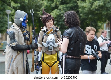Mannheim, Germany - August 2019: Cosplayers from game 'Overwatch' in public park in front of water tower in Mannheim during anual anime and manga convention