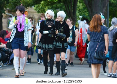 Mannheim, Germany - August 2019: Cosplayers from computer game called 'Nier Automata'walking though public park in in Mannheim during anual anime and manga convention