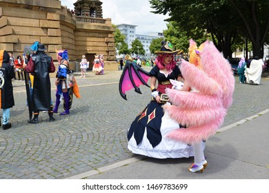 Mannheim, Germany - August 2019: 'League of Legends' online game cosplayers at public park in front of water tower in Mannheim during anual anime convention