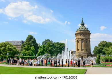 MANNHEIM, GERMANY, AUGUST 22, 2015: Mannheim Water Tower (Mannheimer Wasserturm) a famous landmark with wedding celebration in front of fountain in MANNHEIM