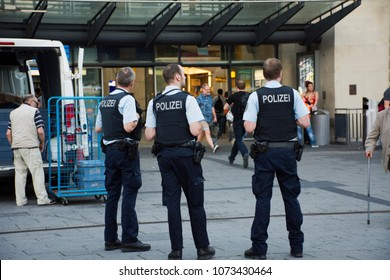 MANNHEIM, GERMANY - AUGUST 29 : German police men standing security for people and travelers at front of Mannheim Hauptbahnhof railway station in morning time on August 29, 2017 in Mannheim, Germany