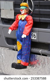 Mannheim, Germany - February 15, 2015: Fastnachtsumzug - carnival parade - traditional public event in the streets of Mannheim drew a crowd of 300.000 viewers. Puppet on front of parade truck.