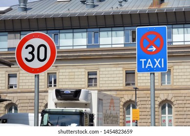 Mannheim, Germany - July 2019: 30kmh speed limit road sign and end of taxi rank parking road sign next to each other