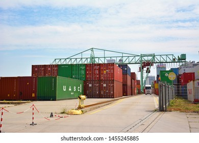 Mannheim, Germany - July 2019: Big industrial container terminal and crates at inland port at Neckar river called 'Salzkai' in Mannheim