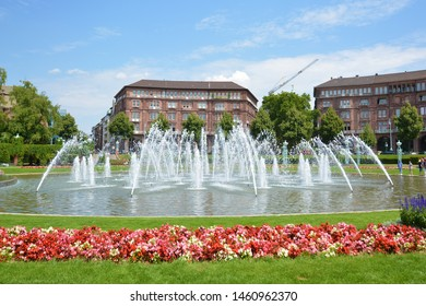 Mannheim, Germany - July 2019: Big water fountains in the city center of Mannheim in small park called 'Friedrichsplatz', a popular place for locals and tourists to rest