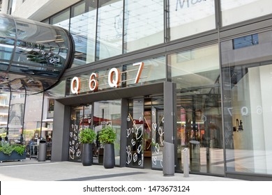 Mannheim, Germany - July 2019: Entrance of  of big modern shopping center called 'Q6 Q7' in Mannheim city