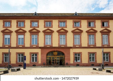 Mannheim, Germany - July 2019: Facade with main entrance of old historical building of public research university of Mannheim