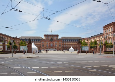 Mannheim, Germany - July 2019: Front view with gates of Mannheim Baroque Palace on summer day