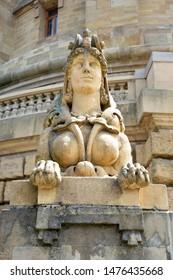 Mannheim, Germany - July 2019: Front view of greek female Sphinx sandstone sculpture at Water Tour called 'Wasserturm' in Mannheim