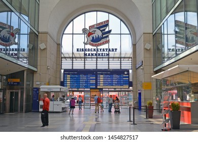 Mannheim, Germany - July 2019: Inside of Mannheim main station with blue digital train arrival and departure time table