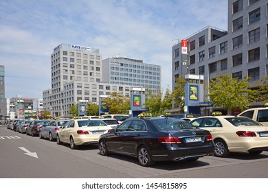 Mannheim, Germany - July 2019: Many taxi cars in different colors parking and waiting for passangers in front of Mannheim main station