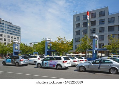Mannheim, Germany - July 2019: Many taxi cars parking and waiting for passangers in front of Mannheim main station