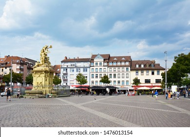 Mannheim, Germany - July 2019: Mannheim marketplace square with fountain with sculpure of god Merkur, patron goddess and Rhine by Peter van den Branden and outdoor cafes on a sunny summer day