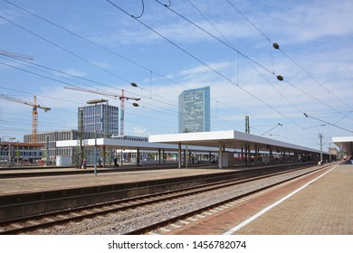 Mannheim, Germany - July 2019: Tracks and platforms of Mannheim main train station on summer day with blue sky