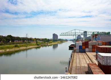 Mannheim, Germany - July 2019: View on industrial container terminal and crates at inland port at Neckar river called 'Salzkai' in Mannheim