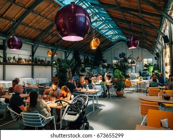 MANNHEIM, GERMANY - JUN 30, 2017: Interior of the famous authentic German  restaurant Oh Julia! family restaurant - interior of people