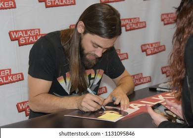 MANNHEIM, GERMANY - MAR 17th 2018: Tom Payne (*1982, actor, Paul 'Jesus' Rovia on The Walking Dead) signing autographs for fans at Walker Stalker Germany