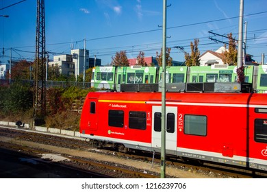 Mannheim/ Germany - October 16 2018:  Tram and train on different trail ways transporting passengers to their destination
