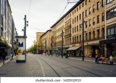 Mannheim, Germany/Baden Württemberg-June 09 2019 Planken street of Mannheim with people joining free time and eating ice crem