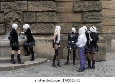 """Mannheim, Hessen/ Germany - August 3, 2019: different costumed people posing in the context of the """"AnimagiC"""" convention in the park at the water tower in Mannheim"""