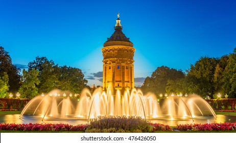 Mannheim Water Tower Germany, with smooth fountain waves in the foreground