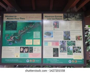Manoa Fall, Oahu, Hawaii, USA, Nov. 20, 2017: After a pleasent hike on Manoa Falls Trail people take a break enjoying the spectacular nature and waterfall