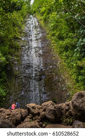 Manoa Falls, Honolulu, Hawaii - March 26, 2017: tourists hike the koolau rainforest in manoa to reach the pool at the base of the manoa falls waterfall