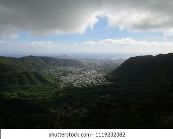 Manoa town Honolulu city view from the mountain with diamond head on a cloudy sunny day