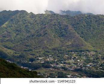 Manoa Valley and Mountains on the Island of Oahu. Featuring houses, school, trees and graveyard.