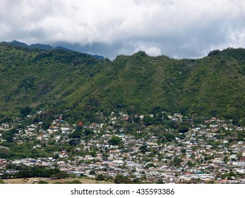Manoa Valley on the Island of Oahu.  Featuring Mountains, houses, school and graveyard.