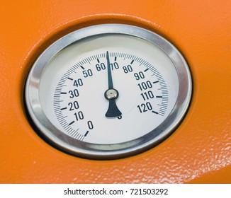 Manometer. Close-up. Isolated on orange background
