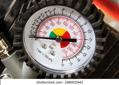 Manometer gauge for measuring gas pressure in the compressor. Manometro close up.